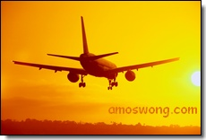 Aircraft Landing In Sunset